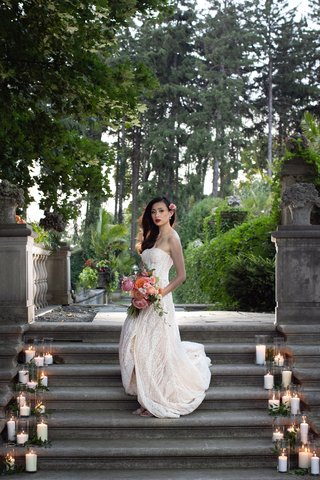 styled-shoot-wedding-inspiration-bride-in-mira-zwillinger-peachy-bouquet-candles-on-steps