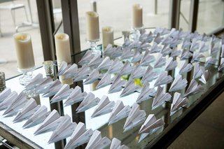 reception-escort-cards-in-the-form-of-paper-airplanes-to-honor-grooms-profession-as-a-pilot