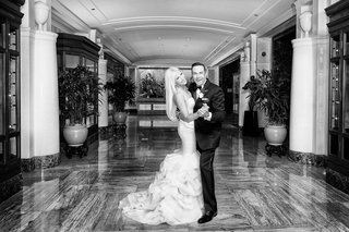 black-and-white-photo-of-bride-in-rivini-wedding-dress-and-groom-in-tuxedo