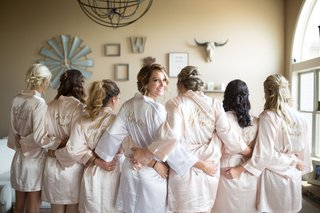 bride-and-bridesmaids-in-embroidered-robes-champagne-bridesmaid-robes