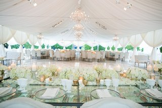 wedding-reception-table-glass-tabletop-crystals-white-glassware-flowers-gold-candle-votives