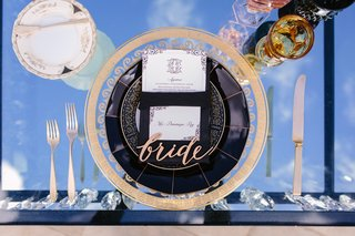 laser-cut-bride-place-setting-ornate-gold-and-clear-charger-mirror-top-sweetheart-table