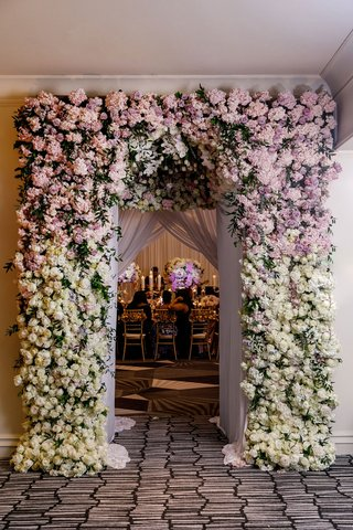 wedding-reception-inspiration-floral-archway-entrance-to-ballroom-purple-and-pink-white-roses-flower