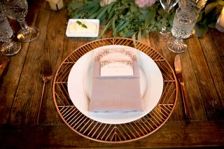 wedding-reception-wood-table-with-copper-rose-gold-charger-place-foil-menu-card-greenery