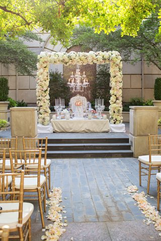 rose-altar-chandelier-small-table-candelabra-gold-chairs-petal-aisle