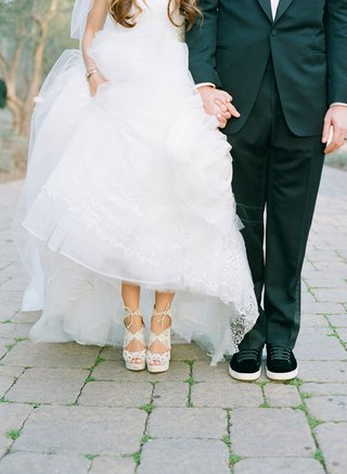 bride-with-white-pedicure-belinda-charlotte-olympia-shoes-and-adam-ottavino-in-black-sneakers