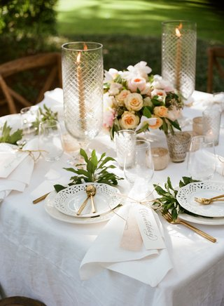 wedding-reception-square-sweetheart-table-white-linen-tablecloth-white-cutout-plates-gold-flatware