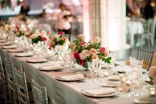 long-wedding-reception-table-silver-chairs-and-linens-low-centerpieces-pink-roses-and-peonies