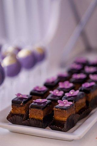 chocolate-ganache-bite-size-wedding-reception-dessert-with-edible-purple-flower-decoration-pearl-dot