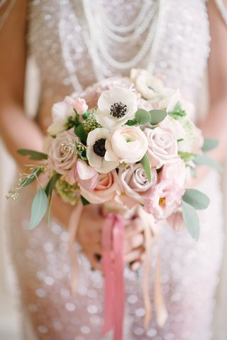 brides-bouquet-of-white-anemones-and-ranunculus-and-pink-roses-and-lisianthus