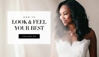 bride-in-a-strapless-lace-gown-with-locket