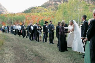 newlyweds-thanking-guests-outside-with-fall-leaves