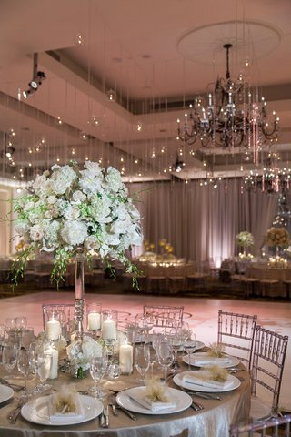 silver-tablescape-underneath-hanging-lights-edison-bulbs-crystals-dance-floor-wedding-chandelier