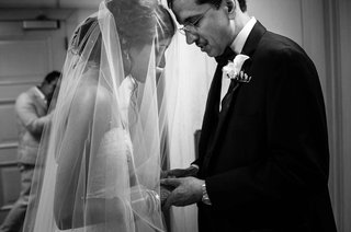 black-and-white-photo-of-father-of-the-groom-and-bride-before-ceremony