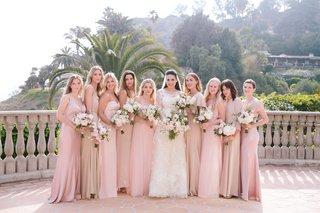 bride-in-vera-wang-bridesmaids-in-ghost-bhldn-reformation-joanna-august