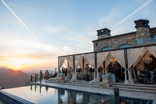 malibu-rocky-oaks-vineyard-reception-overlooking-the-mountains-with-sheer-drapery-on-terrace-pool