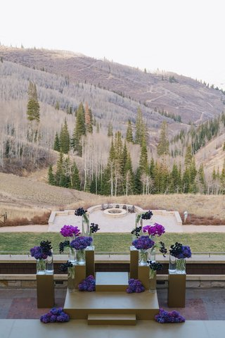 wedding-ceremony-outdoors-montage-deer-valley-purple-flowers-gold-decorations-view-of-mountain