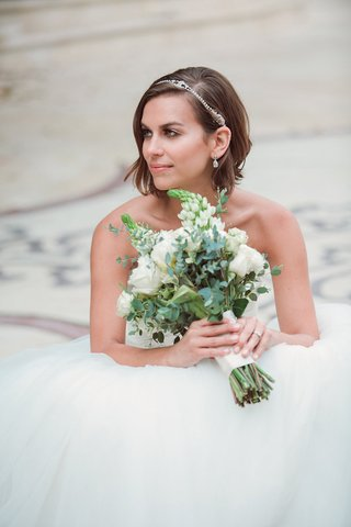 bride-in-a-strapless-anne-barge-gown-with-tulle-skirt-rhinestone-headband-diamond-drop-earrings