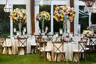 tent-wedding-reception-private-residence-tall-centerpieces-blue-pink-yellow-flowers-greenery