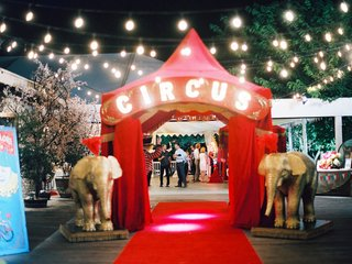 red-curtains-circus-marquee-letters-red-tent-gold-elephant-decor-outdoor-wedding-cafe-lights-cj