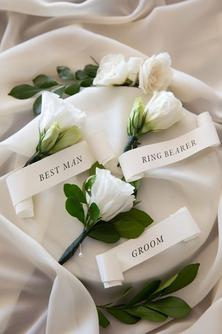 wedding-boutonniere-flower-white-bloom-greenery-banner-ribbon-with-groom-best-man-ring-bearer-pins