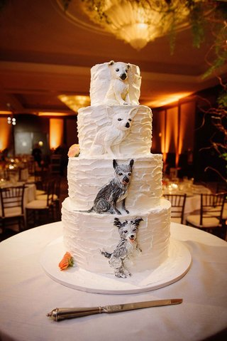 white-four-layer-wedding-cake-with-buttercream-frosting-dog-replica-designs-on-each-tier-orange