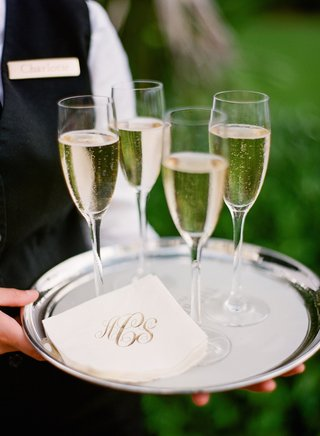 silver-platter-topped-with-monogrammed-napkins