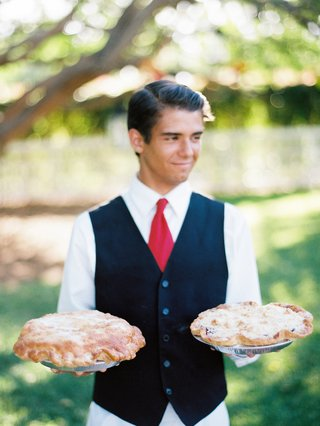 wedding-catering-server-holding-thyme-in-the-ranch-pies-at-outdoor-wedding