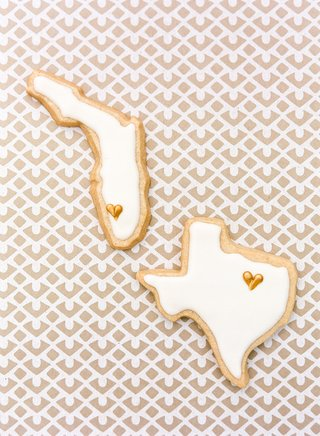 frosted-cookies-in-the-shape-of-florida-and-texas-served-at-a-wedding