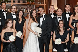 bride-and-groom-with-tuxedo-groomsmen-and-black-dress-bridesmaids