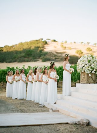 bridesmaids-at-ceremony-wearing-flower-crowns