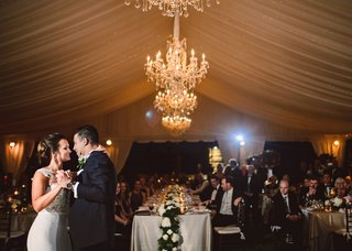 wedding-reception-tent-with-crystal-chandelier-bride-and-groom-first-dance-wedding-ideas-tent