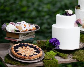 outdoor-wedding-reception-dessert-table-with-teacakes-berry-pie-and-white-wedding-cake