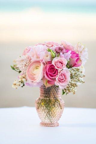 wedding-reception-centerpiece-pink-rose-ranunculus-flowers-in-light-pink-crystal-vase-beach-ocean
