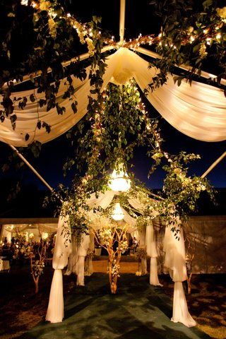 garlands-of-greenery-and-white-fabric-arch