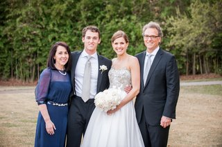 newlyweds-with-mother-of-the-groom-and-father