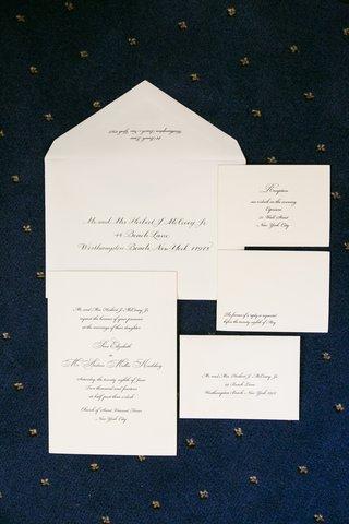 simple-script-font-wedding-invitations-on-blue-background