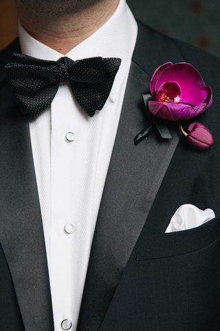 groom-in-hugo-boss-tuxedo-with-bow-tie-wearing-fuchsia-purple-orchid-boutonniere