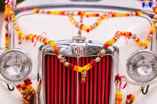 classic-car-wedding-getaway-car-with-flowers-on-it