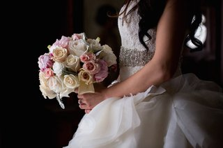 bride-in-a-strapless-lazaro-dress-with-lace-bodice-ruffled-skirt-pink-white-rose-bouquet