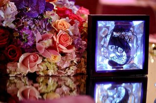 crystal-jewels-and-blue-lighting-in-table-number