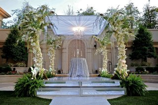 alfresco-ceremony-canopy-with-floral-embellished-pillars