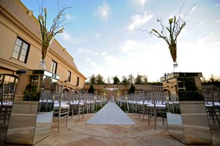 silver-chairs-and-aisle-at-outdoor-ceremony