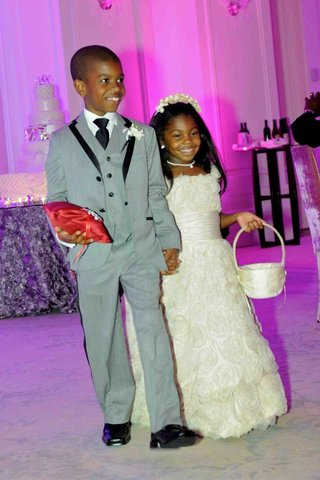 syre-stewart-holding-hand-of-african-american-flower-girl