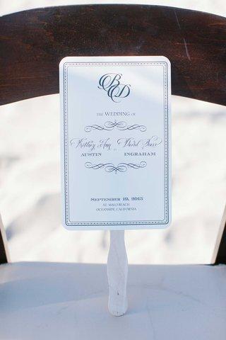 blue-white-ceremony-program-fan-calligraphy-beach-wedding-california-pacific-ocean