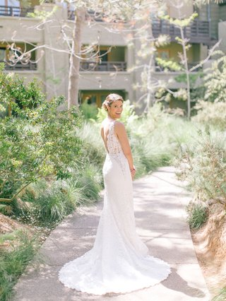 bride-in-lace-wedding-dress-with-v-neck-and-v-back-hair-in-low-bun-the-lodge-at-torrey-pines-wedding