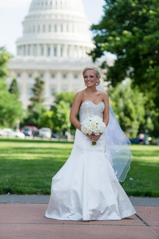 blonde-bride-holding-bouquet-in-front-of-u-s-capitol