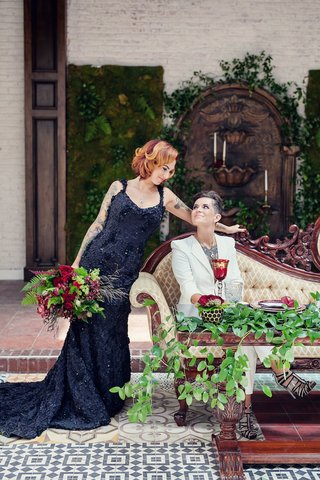 bride-in-a-black-r-mine-bespoke-dress-with-appliques-chapel-train-with-bride-in-white-blazer