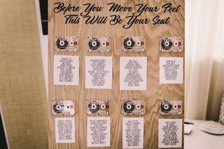 wooden-board-for-seat-assignment-mix-tape-table-assignments-wedding-tables-after-rappers