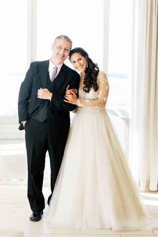 bride-in-long-sleeve-sheer-wedding-dress-with-father-in-three-piece-suit-and-lavender-tie